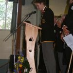 Prefect reading Roll of Honour